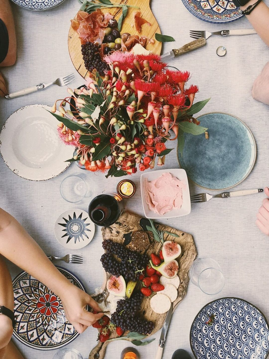 Parisian Christmas styling: an overhead photo of a table setting with cutlery, plates and food