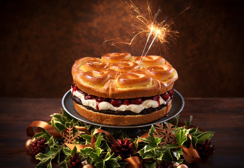 A photo of a St Pierre Brioche Tear and Share with a sparkler alight placed in the top