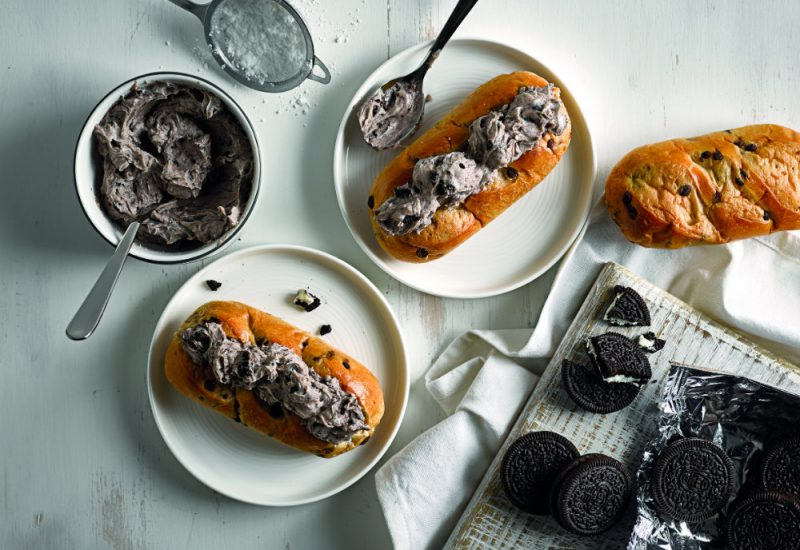 An overhead photo of chocolate chip brioche rolls filled with a crush Oreo biscuit and cream filling