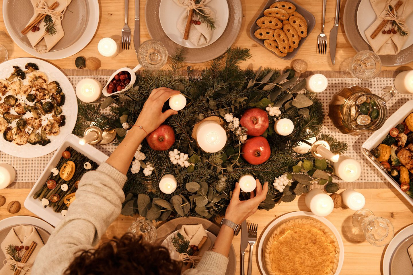 An overhead photo of a Christmas table with food and decorations