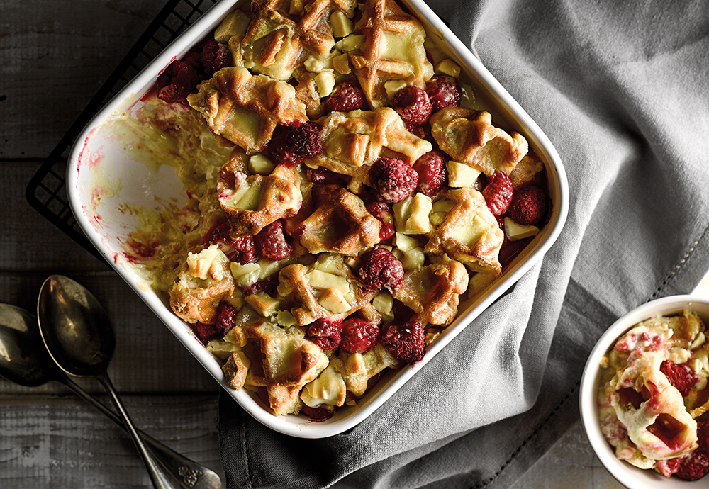 An overhead photo of a waffle and fruit bake in a big ovenproof dish