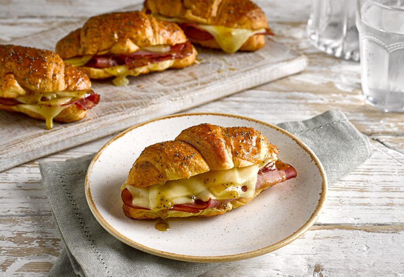 Ham & Cheese Croissant recipe featuring St Pierre All Butter Croissants on a table filled with melted cheese and ham