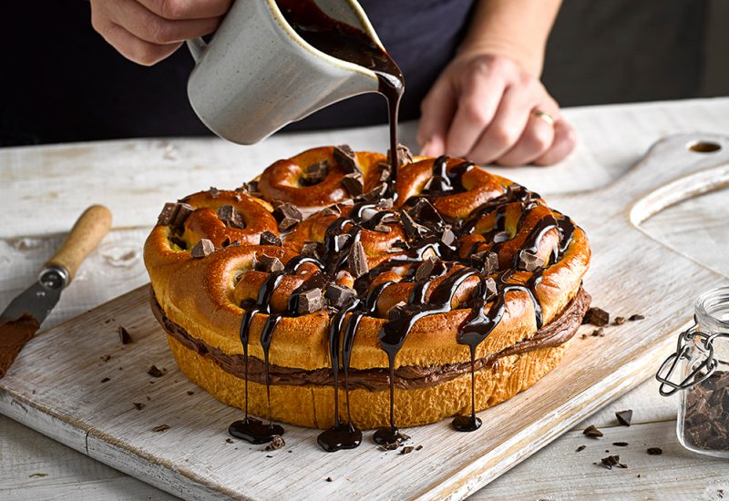 Our Brioche Chocolate Sharer Dessert recipe drizzled with chocolate sauce